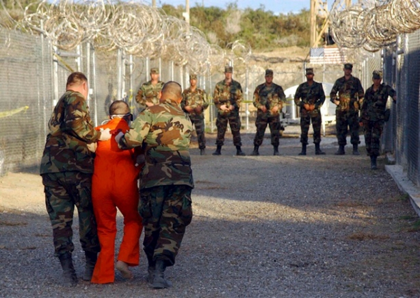 File photo of U.S. Army Military police escorting a detainee to his cell in Naval Base Guantanamo Bay