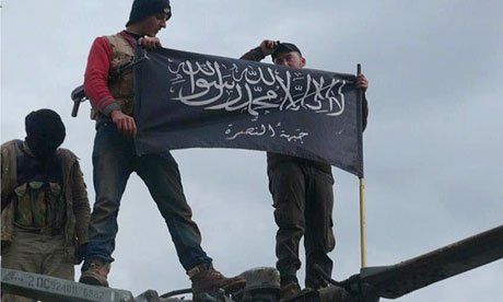 Al-Qaida affiliated Jabhat al-Nusra rebels hold up their flag after capturing Taftanaz air base