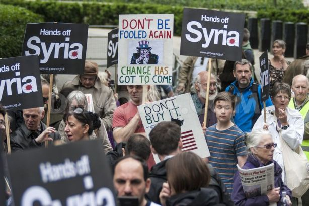 1371313881-antiwar-activists-protest-against-us-and-british-involvement-in-syria_2156918