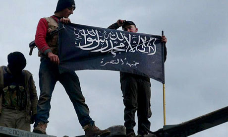 Jabhat al-Nusra fighters at Taftanaz airbase, Idlib province, in January 2013