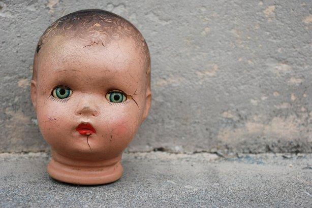 antique_doll_head_against_cement_by_cassiehillis-d68976j