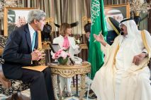 Saudi King Abdullah bin Abdulaziz al-Saud and U.S. Secretary of State John Kerry wait for a meeting at the King's private residence in the Red Sea city of Jeddah