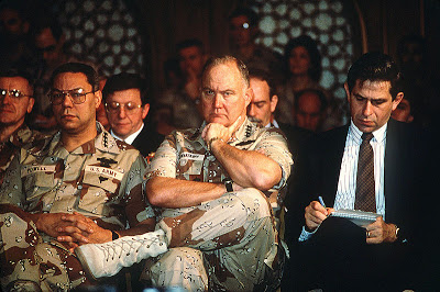 800px-Powell,_Schwarzkopf,_and_Wolfowitz_at_Cheney_press_conference,_February_1991