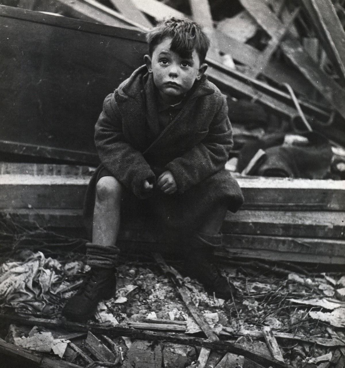 FrisselToni_1945_BoySittingInTheRubbleOfHisHomeWhereHisParentsLieBurriedAfterV2BombHit_London