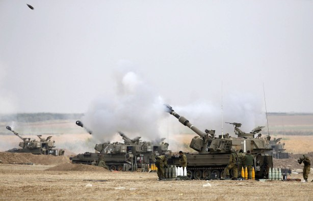 An Israeli mobile artillery unit fires towards Gaza
