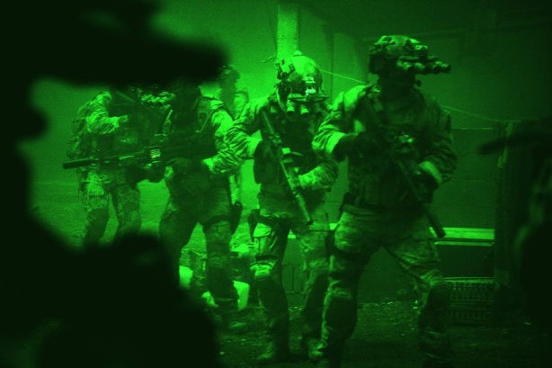 AP PROVIDES ACCESS TO THIS PUBLICLY DISTRIBUTED HANDOUT PHOTO PROVIDED BY COLUMBIA PICTURES INDUSTRIES, INC. FOR EDITORIAL PURPOSES ONLY. © 2012 COLUMBIA PICTURES INDUSTRIES, INC. ALL RIGHTS RESERVED. NO SALES. 6 MONTHS USE FROM JAN. 10, 2013. This undated publicity photo released by Columbia Pictures Industries, Inc. shows Navy SEALs seen through the greenish glow of night vision goggles, as they prepare to breach a locked door in Osama Bin Laden's compound in Columbia Pictures' hyper-realistic new action thriller from director Kathryn Bigelow,