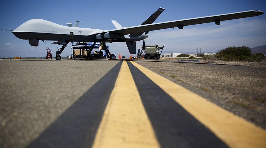 """A General Atomics MQ-9 Reaper stands on the runway during """"Black Dart"""", a live-fly, live fire demonstration of 55 unmanned aerial vehicles, or drones, at Naval Base Ventura County Sea Range, Point Mugu, near Oxnard, California July 31, 2015. REUTERS/Patrick T. Fallon      TPX IMAGES OF THE DAY      - RTX1MMQ9"""