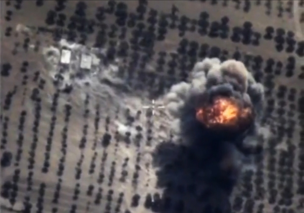 epa04978545 A handout frame grab taken from a video footage made available on the official website of the Russian Defence Ministry on 15 October 2015 shows an aerial view of bomb explosion after airsrike carried out by Russian Su-24M bomber against so-called Islamic State (ISIS or IS) facilities in Idlib province, Syria. Backed by a Russian air campaign, Syria said that its troops started a wide-scale attack on rebel-held areas in the central province of Homs on 15 October 2015. More than 15 Russian airstrikes were carried out from the early hours of the day on the outskirts of Talbisseh and Teir Maaleh.  EPA/RUSSIAN DEFENCE MINISTRY PRESS SERVICE/HANDOUT BEST QUALITY AVAILABLE HANDOUT EDITORIAL USE ONLY/NO SALES