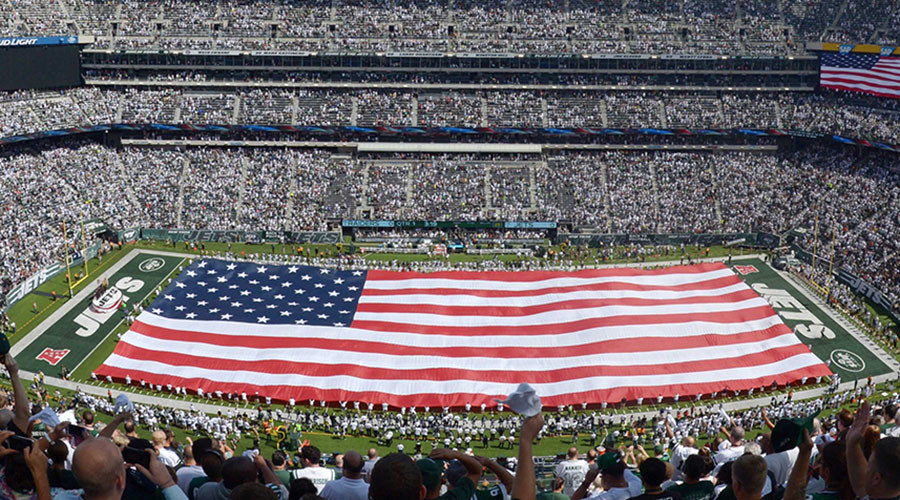 Sep 7, 2014; East Rutherford, NJ, USA; General view of the playing of the national anthem with a United States flag on the field before the NFL game between the Oakland Raiders and New York Jets at MetLife Stadium. Mandatory Credit: Kirby Lee-USA TODAY Sports - RTR459LN