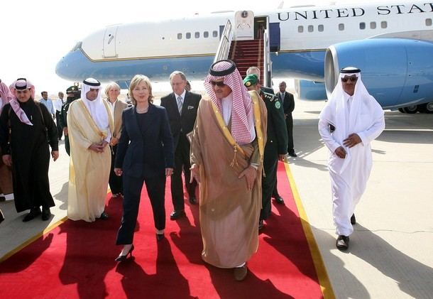 Saudi Arabia's Foreign Minister Prince Saud Al Faisal welcomes U.S. Secretary of State Hillary Clinton upon her arrival at Riyadh airport