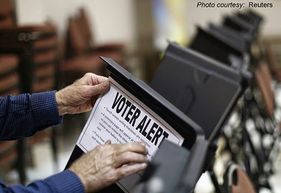 voter-alert-sign-on-voting-machine