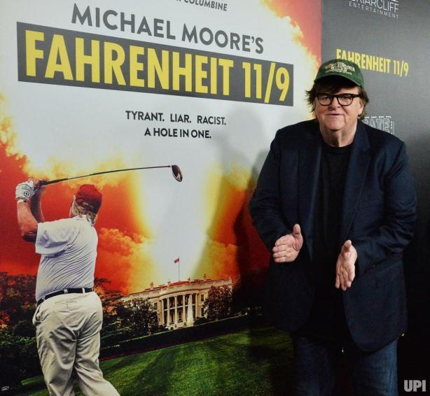 Michael-Moore-Omarosa-Manigault-Newman-attend-Fahrenheit-119-premiere_2_1